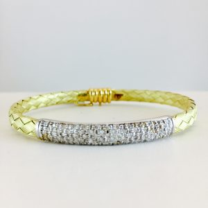 Yellow gold woven bangle with pave diamond