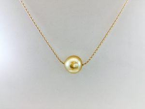 Single pearl on gold chain