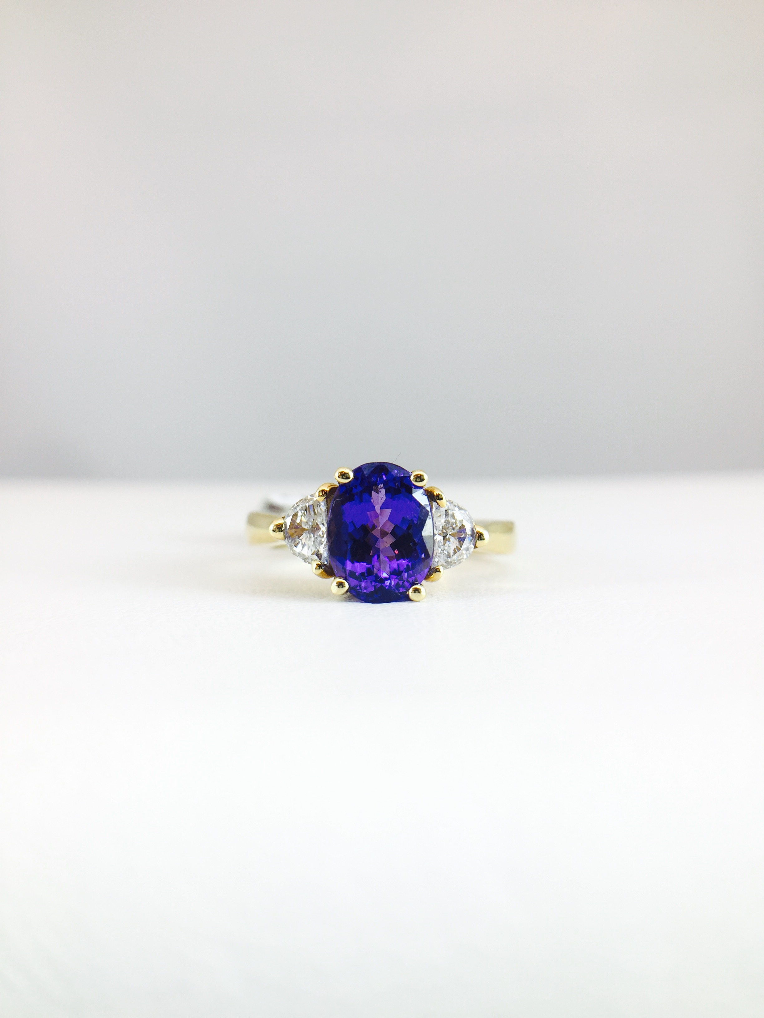 ring product jewelers trillion tanzanite and bennion fullsizerender diamond
