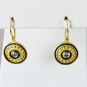 Seize the day with these gold shield earrings